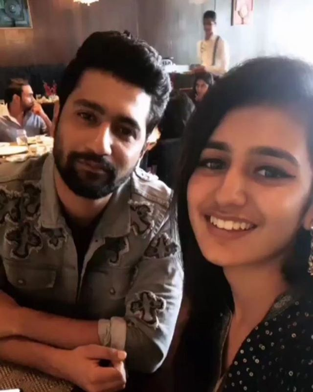 Watch !! Wink Girl Priya Varrier Recreates The Finger Gun Kiss With Vicky Kaushal !!