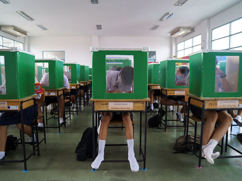 Students in Thailand use old ballot boxes to practice Social Distancing In School!!